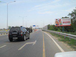 Краснодар рекламный щит Красная площадь Немецкая деревня Дзержинского напротив 700м № 100 (западный обход)